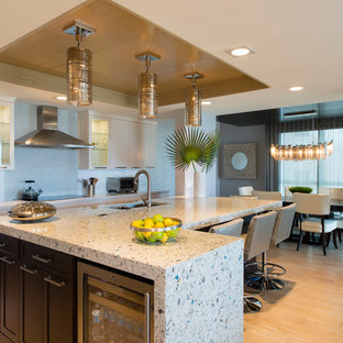 Design ideas for a large contemporary l-shaped open plan kitchen in Miami with an undermount sink, shaker cabinets, terrazzo benchtops, grey splashback, ceramic splashback, stainless steel appliances, porcelain floors and with island.
