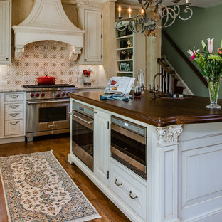 Inspiration for a timeless l-shaped eat-in kitchen remodel in Baltimore with beaded inset cabinets, beige cabinets, granite countertops, multicolored backsplash, ceramic backsplash and stainless steel appliances