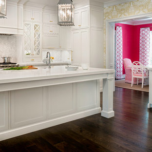 Large traditional eat-in kitchen ideas - Eat-in kitchen - large traditional u-shaped dark wood floor eat-in kitchen idea in Jacksonville with a farmhouse sink, beaded inset cabinets, white cabinets, stainless steel appliances, an island and white countertops