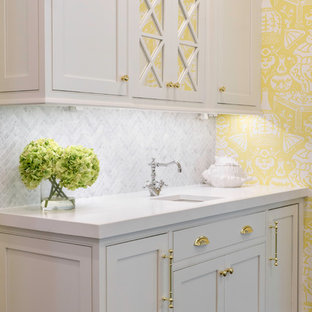 Large traditional eat-in kitchen designs - Inspiration for a large timeless u-shaped dark wood floor eat-in kitchen remodel in Jacksonville with a farmhouse sink, beaded inset cabinets, white cabinets, stainless steel appliances, an island and white countertops