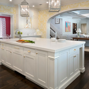 Large traditional eat-in kitchen inspiration - Eat-in kitchen - large traditional u-shaped dark wood floor eat-in kitchen idea in Jacksonville with a farmhouse sink, beaded inset cabinets, white cabinets, stainless steel appliances, an island and white countertops