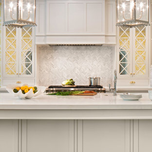 Large traditional eat-in kitchen designs - Large elegant u-shaped dark wood floor eat-in kitchen photo in Jacksonville with a farmhouse sink, beaded inset cabinets, white cabinets, stainless steel appliances, an island and white countertops