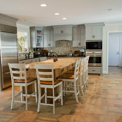 Eat-in kitchen - large transitional u-shaped porcelain tile eat-in kitchen idea in Philadelphia with mosaic tile backsplash, stainless steel appliances, a farmhouse sink, shaker cabinets, gray cabinets, granite countertops, multicolored backsplash and an island
