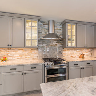 Inspiration for a large transitional l-shaped eat-in kitchen in Detroit with an undermount sink, shaker cabinets, grey cabinets, quartzite benchtops, multi-coloured splashback, slate splashback, stainless steel appliances, ceramic floors, with island, beige floor and multi-coloured benchtop.