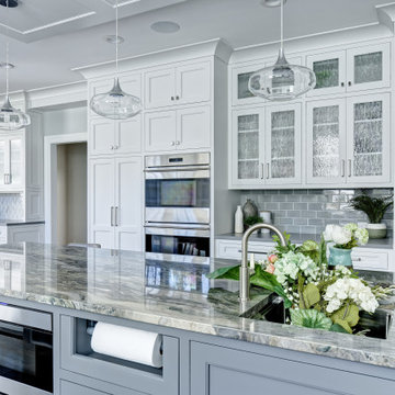 A Light Filled White Kitchen with Seafoam Accents