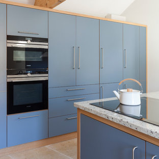 Medium sized contemporary l-shaped kitchen/diner in Wiltshire with a single-bowl sink, flat-panel cabinets, grey cabinets, granite worktops, integrated appliances, limestone flooring, an island and beige floors.