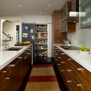 Example of a trendy galley kitchen design in DC Metro with an undermount sink, flat-panel cabinets, medium tone wood cabinets and gray backsplash