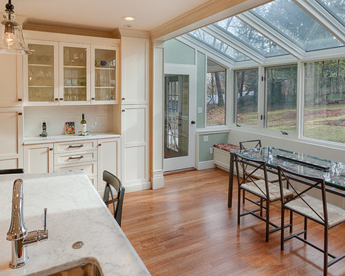 Inspiration For A Mid Sized Timeless Medium Tone Wood Floor Eat In Kitchen Remodel