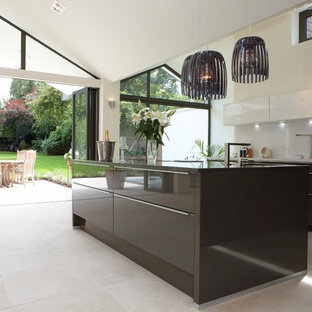 Inspiration for an expansive contemporary kitchen/diner in Berkshire with limestone flooring and an island.