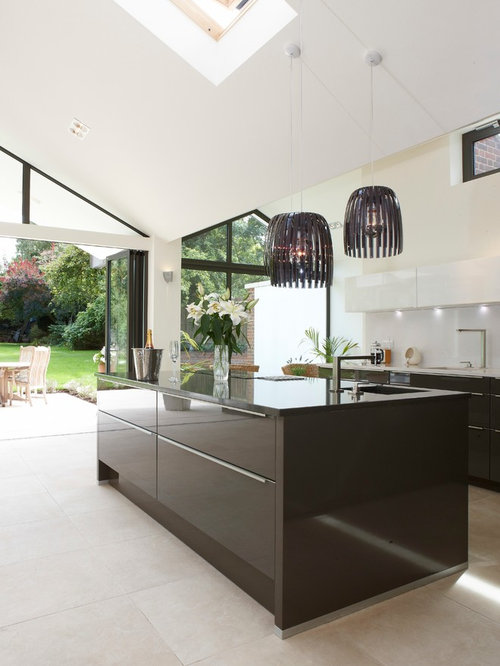 inspiration for an expansive contemporary kitchendiner in berkshire with limestone flooring an island