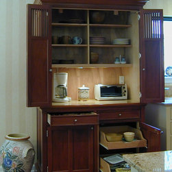 A Real Working Pantry - The working pantry is located between the kitchen and the breakfast room. It is used to store the dishes for the table as well as a prep, buffet counter space for small appliances that can be hidden when they aren't in use.
