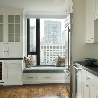 Small traditional eat-in kitchen designs - Eat-in kitchen - small traditional u-shaped eat-in kitchen idea in Boston with an undermount sink, recessed-panel cabinets, white cabinets, gray backsplash, subway tile backsplash, stainless steel appliances and an island
