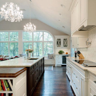 Inspiration for a timeless dark wood floor open concept kitchen remodel in Boston with an undermount sink, recessed-panel cabinets, white cabinets, quartzite countertops, white backsplash and marble backsplash