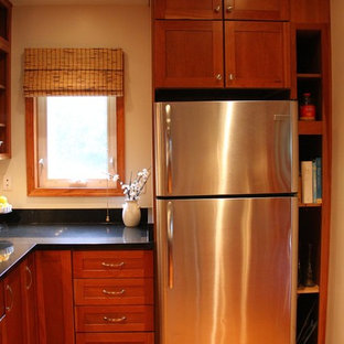 Small traditional enclosed kitchen remodeling - Enclosed kitchen - small traditional l-shaped medium tone wood floor enclosed kitchen idea in DC Metro with an undermount sink, shaker cabinets, medium tone wood cabinets, granite countertops, stainless steel appliances and no island