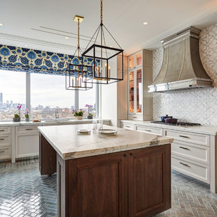 Transitional kitchen remodeling - Inspiration for a transitional l-shaped gray floor kitchen remodel in Chicago with an undermount sink, recessed-panel cabinets, beige cabinets, white backsplash, paneled appliances, an island and white countertops