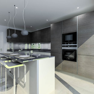 This is an example of a medium sized modern l-shaped kitchen/diner in Hertfordshire with a single-bowl sink, flat-panel cabinets, dark wood cabinets, quartz worktops, blue splashback, glass sheet splashback, black appliances and an island.