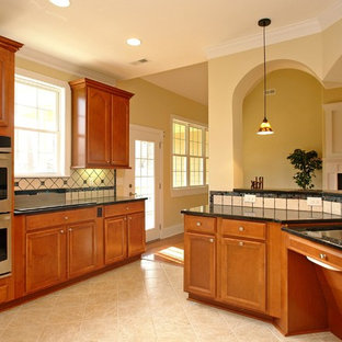 Inspiration for a large timeless u-shaped ceramic floor open concept kitchen remodel in Raleigh with a double-bowl sink, recessed-panel cabinets, medium tone wood cabinets, granite countertops, white backsplash, ceramic backsplash, stainless steel appliances and an island