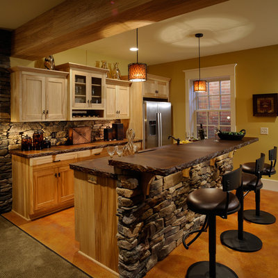 Inspiration for a rustic galley kitchen remodel in Columbus with stainless steel appliances, concrete countertops, shaker cabinets and light wood cabinets
