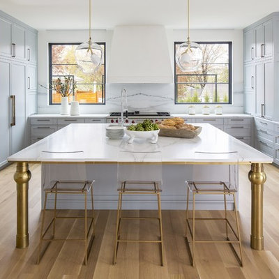 Example of a large transitional u-shaped light wood floor and beige floor open concept kitchen design in DC Metro with shaker cabinets, gray cabinets, marble countertops, white backsplash, marble backsplash, paneled appliances, an island, white countertops and an undermount sink