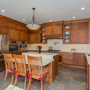 Huge transitional open concept kitchen appliance - Inspiration for a huge transitional u-shaped open concept kitchen remodel in Other with an undermount sink, shaker cabinets, medium tone wood cabinets, quartz countertops, stone slab backsplash, stainless steel appliances and an island