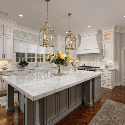 Large elegant u-shaped dark wood floor and brown floor eat-in kitchen photo in DC Metro with a farmhouse sink, recessed-panel cabinets, white cabinets, multicolored backsplash, stainless steel appliances, an island, multicolored countertops, marble countertops and mosaic tile backsplash