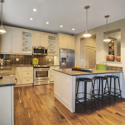 Trendy l-shaped kitchen photo in Edmonton with stainless steel appliances