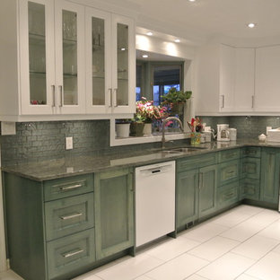 Design ideas for a mid-sized tropical u-shaped eat-in kitchen in Other with an undermount sink, shaker cabinets, green cabinets, granite benchtops, green splashback, glass tile splashback, white appliances, ceramic floors and no island.