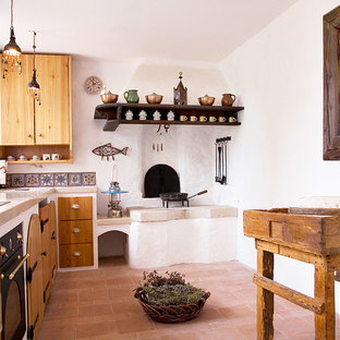 Small mediterranean u-shaped eat-in kitchen in Other with an integrated sink, open cabinets, medium wood cabinets, limestone benchtops, multi-coloured splashback, ceramic splashback, white appliances, no island and terra-cotta floors.