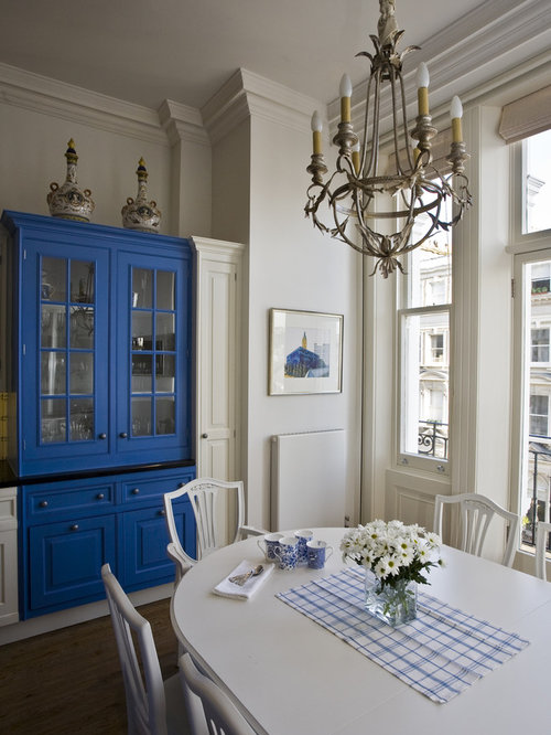 Elegant Eat In Kitchen Photo London With Blue Cabinets