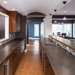 Medium sized classic galley open plan kitchen in Minneapolis with a built-in sink, glass-front cabinets, medium wood cabinets, concrete worktops, multi-coloured splashback, matchstick tiled splashback, stainless steel appliances, plywood flooring and an island.