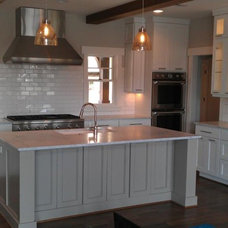Contemporary Kitchen by Against the Grain Woodworking, Inc.