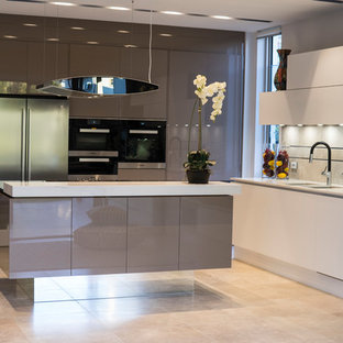 Contemporary l-shaped kitchen in Adelaide with a double-bowl sink, flat-panel cabinets, grey cabinets, beige splashback, stainless steel appliances, with island and beige floor.