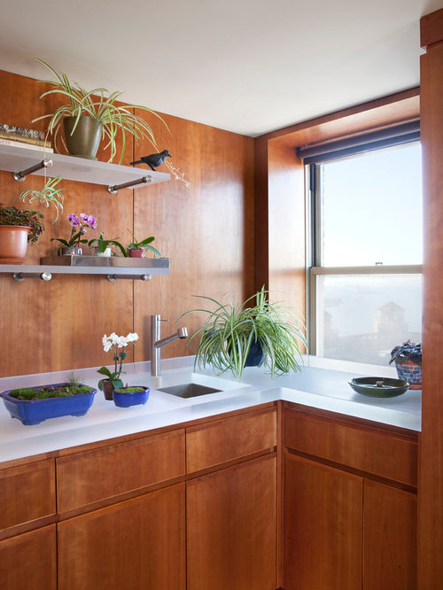 Small Minimalist L Shaped Enclosed Kitchen Photo In New York With An  Undermount Sink,