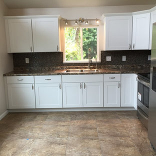 Photo of a small tropical u-shaped eat-in kitchen in Hawaii with a single-bowl sink, shaker cabinets, white cabinets, laminate benchtops, multi-coloured splashback, ceramic splashback, stainless steel appliances and ceramic floors.