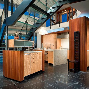 This is an example of a large contemporary l-shaped open plan kitchen in Phoenix with an undermount sink, flat-panel cabinets, light wood cabinets, terrazzo benchtops, white splashback, stainless steel appliances, porcelain floors and with island.