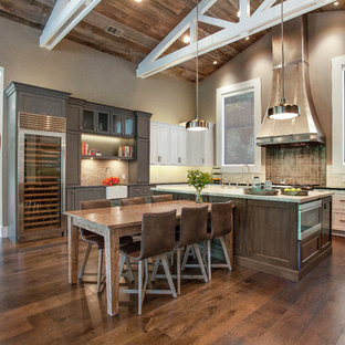 Photo of a large country u-shaped eat-in kitchen in San Francisco with recessed-panel cabinets, white cabinets, soapstone benchtops, grey splashback, stainless steel appliances, medium hardwood floors and with island.