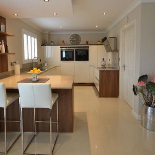 Photo of a mid-sized contemporary u-shaped eat-in kitchen in Other with a double-bowl sink, flat-panel cabinets, medium wood cabinets, laminate benchtops, white splashback, timber splashback, coloured appliances, marble floors, no island and white floor.
