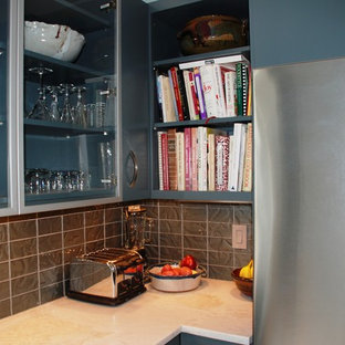 Photo of a large midcentury l-shaped eat-in kitchen in DC Metro with flat-panel cabinets, grey splashback, stainless steel appliances, an undermount sink, blue cabinets, laminate benchtops, mosaic tile splashback, porcelain floors and no island.