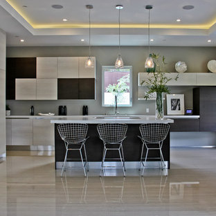 Eat-in kitchen - large contemporary l-shaped porcelain floor eat-in kitchen idea in Los Angeles with flat-panel cabinets, light wood cabinets, stainless steel appliances, an undermount sink and an island