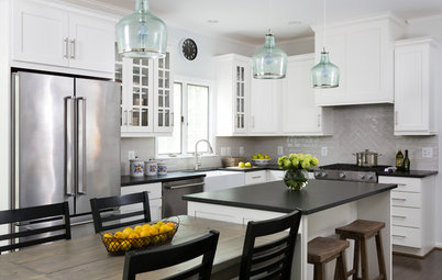 White Cabinets and Black Countertops Make a Winning Combination