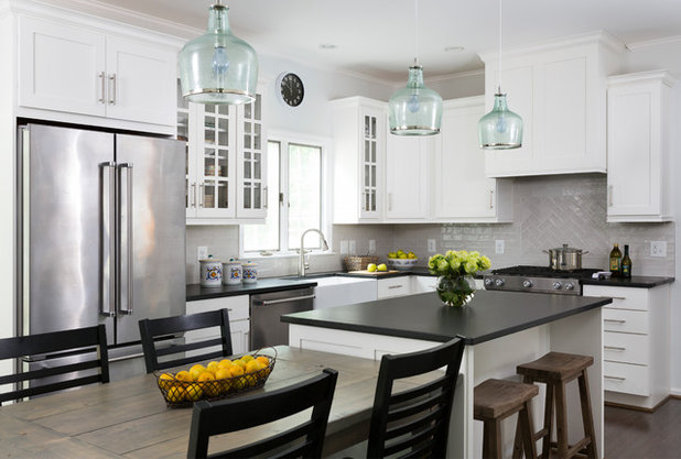 White Cabinets and Black Countertops Make a Winning Combination on kitchens with cherry cabinets, most expensive kitchen countertops, kitchens with black floors, kitchens with black cabinets, shiny black laminate countertops, black laminate kitchen countertops, kitchens with black faucets, granite countertops, dark countertops, kitchens with black pearl granite, kitchens with black tables, kitchens with black islands, kitchens with black sinks, kitchens with dishwasher, black corian countertops, black slate countertops, redo kitchen countertops, kitchens with black paint, kitchens with black stainless steel, kitchens with black appliances,