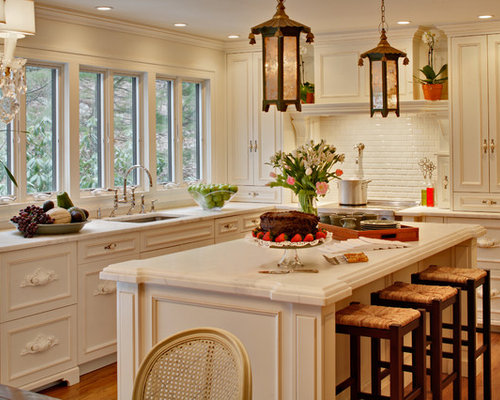 example of a cottage chic kitchen design in new york with recessed panel cabinets - French Kitchen Design Ideas