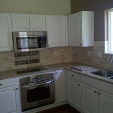 Kitchen by Remodeling and Painting Experts Inc.
