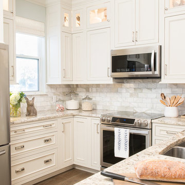 All White Cottage Style Kitchen with Stacked Cabinetry