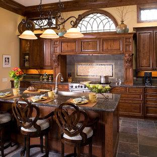 Elegant kitchen photo in Houston with granite countertops
