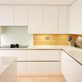 laminate backsplash . Mid-sized trendy kitchen photo in London with white cabinets an island and glass & Laminate Backsplash | Houzz