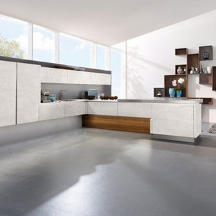 Design ideas for a mid-sized modern l-shaped open plan kitchen in New York with flat-panel cabinets, white cabinets, zinc benchtops, grey splashback, vinyl floors, no island and grey floor.