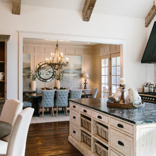 Mid-sized shabby-chic style eat-in kitchen ideas - Mid-sized cottage chic galley medium tone wood floor eat-in kitchen photo in Atlanta with shaker cabinets, white cabinets, granite countertops, travertine backsplash and an island
