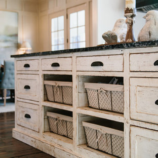Inspiration for a mid-sized shabby-chic style galley eat-in kitchen in Atlanta with shaker cabinets, white cabinets, granite benchtops, travertine splashback, medium hardwood floors and with island.
