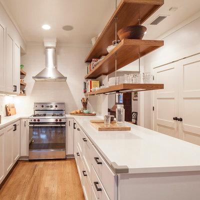 Transitional u-shaped enclosed kitchen photo in Austin with shaker cabinets, white cabinets, white backsplash, subway tile backsplash and stainless steel appliances